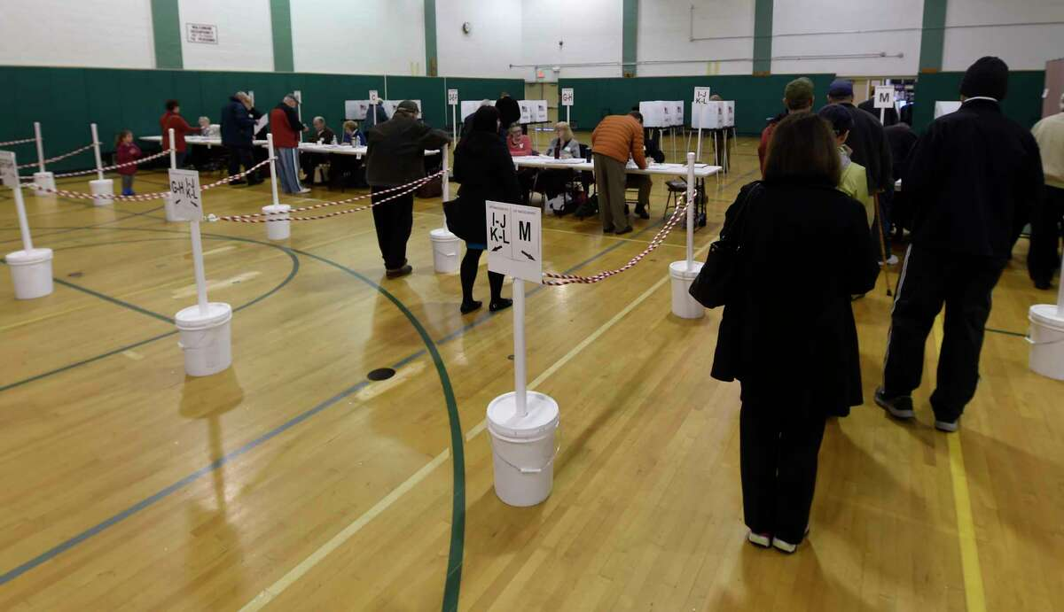 A large group of voters show up at the polls at the Gowana Middle School for the Shenendehowa land vote on Tuesday, April 4, 2017, in Clifton Park, N. Y. Skip Dickstein/Times Union)