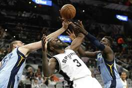 Spurs' Dewayne Dedmon (03) fights for a rebound against Memphis Grizzlies' Marc Gasol (33) and James Ennis, III (08) during their game at the AT&T Center on Tuesday, Apr. 4, 2017. (Kin Man Hui/San Antonio Express-News)