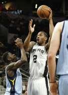 Spurs' Kawhi Leonard (2) takes a shot against the Memphis Grizzlies' James Ennis, III (8) on April 4, 2017.
