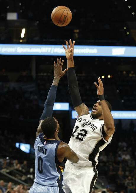 Spurs' LaMarcus Aldridge (12) gets challenged on a shot against Memphis Grizzlies' JaMychal Green (00) during their game at the AT&T Center on Tuesday, Apr. 4, 2017. Photo: Kin Man Hui /San Antonio Express-News / ©2017 San Antonio Express-News