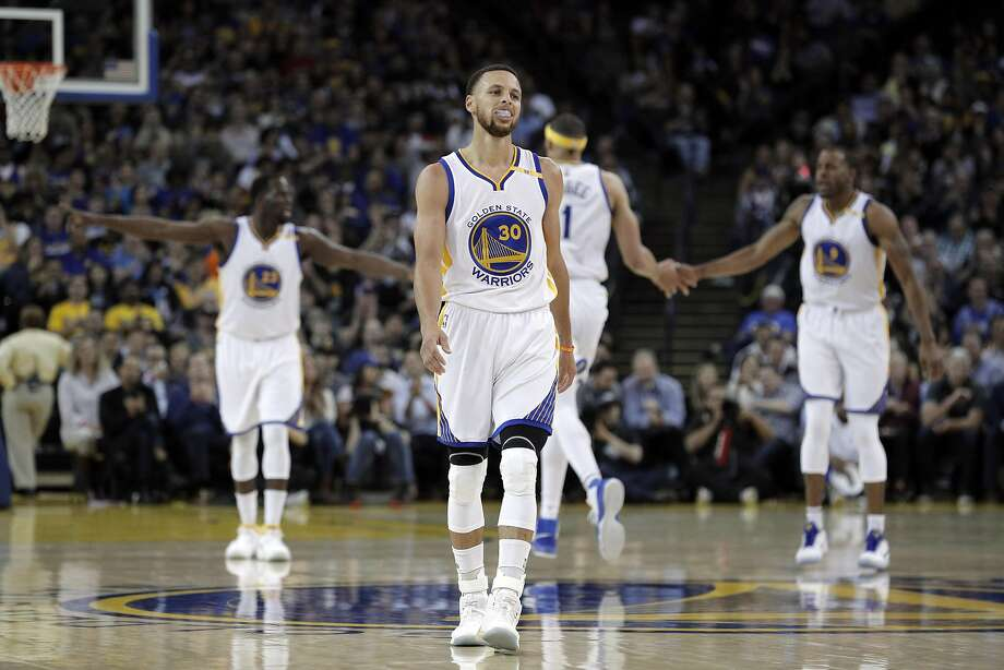 Stephen Curry (30) walks back up court after a scoring play for the Warriors in the first half as the Golden State Warriors played the Minnesota Timberwolves at Oracle Arena in Oakland, Calif., on Tuesday, April 4, 2017. Photo: Carlos Avila Gonzalez, The Chronicle
