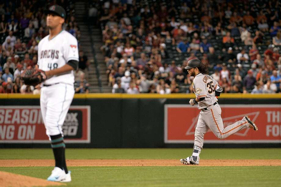 Brandon Crawford #35 of the San Francisco Giants hits a sole homer off Randall Delgado #48 of the Arizona Diamondbacks during the fifth inning at Chase Field on April 4, 2017 in Phoenix, Arizona.  Photo: Jennifer Stewart, Getty Images