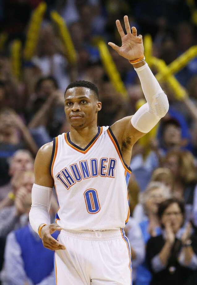 Russell Westbrook waves to the crowd after tying Oscar Robertson's 55-year-old record for triple-doubles in a season. Photo: Sue Ogrocki / Associated Press / AP2017