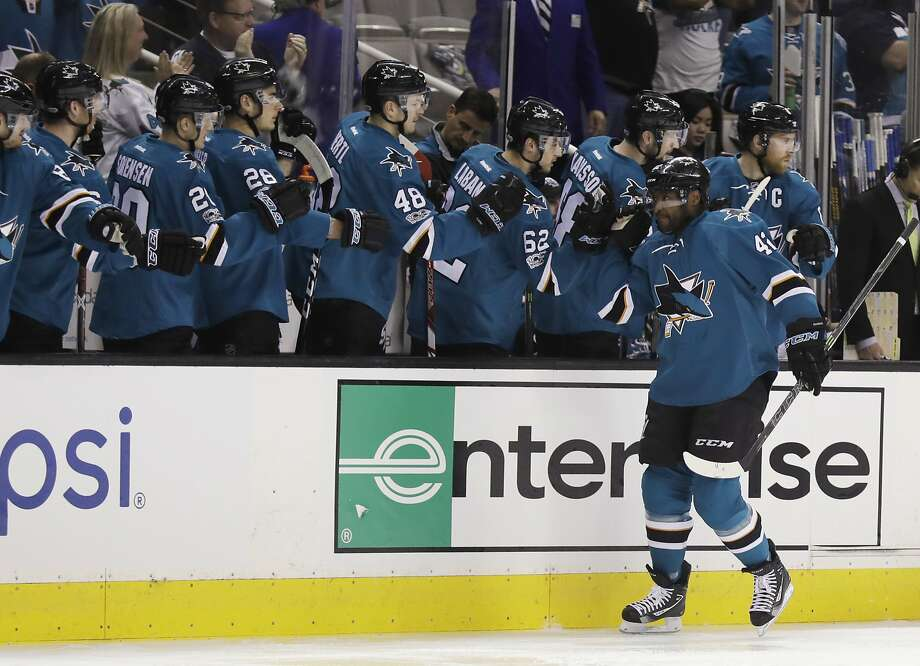 Sharks right wing Joel Ward (right) celebrates with teammates after scoring justt 12 seconds after rookie Kevin Lebanc got the first goal to get the game off to its lightning start, fastest in franchise history. Photo: Marcio Jose Sanchez, Associated Press