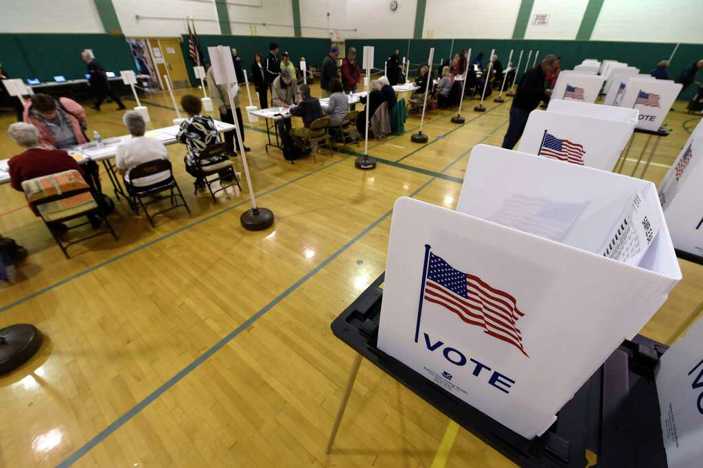 A Large Group Of Voters Show Up At The Polls At The Gowana Middle School For
