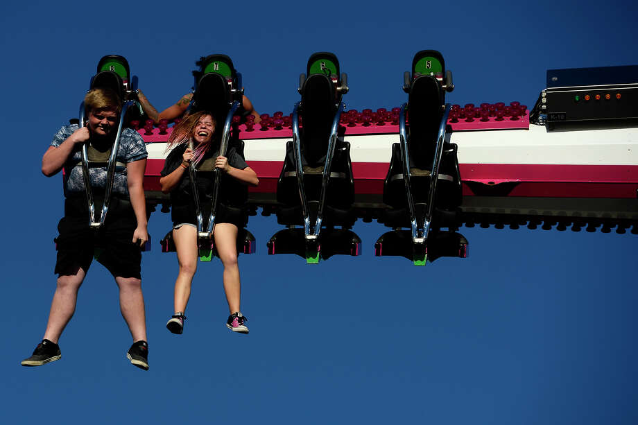 Fair-goers spin through the air on the Tango ride at the YMBL South Texas State Fair on Monday afternoon.  Photo taken Monday 4/3/17 Ryan Pelham/The Enterprise Photo: Ryan Pelham, Ryan Pelham/The Enterprise / ©2017 The Beaumont Enterprise/Ryan Pelham