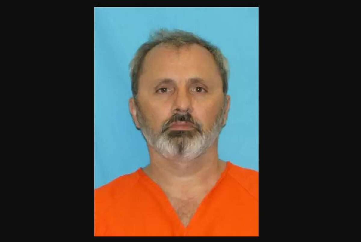 Radu Chivu was arrested for shooting a salesman at his house Monday. Officers said they noted a sign on the home that read: