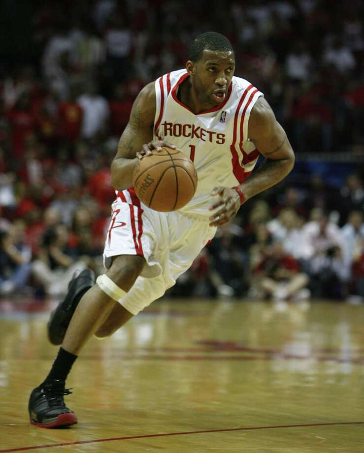 12. Tracy McGrady (2006-07)Honors:All NBA Second-TeamStats: 24.8 points, 6.5 assists, 5.4 rebounds, 23.2 Player Efficiency Rating, 8.6 Win Shares, 5.2Value Over ReplacementTeam: 52-30. Lost to the Jazz in the first round.Unfortunately, Tracy McGrady's best season as a Rocket saw Yao Ming play just 48 games but for that exact reason T-Mac had a season worthy of MVP consideration (McGrady finished sixth in the voting). Yao's unavailability left McGrady as the lone offensive weapon in Houston (unless you think 37 percent-shooting Rafer Alston needed more shots) and McGrady responded, carrying the team to the postseason. An early exit from the playoffs and missing 11 games was the deciding factor compared to No. 11 on the list. Photo: James Nielsen, Houston Chronicle / © 2007 Houston Chronicle