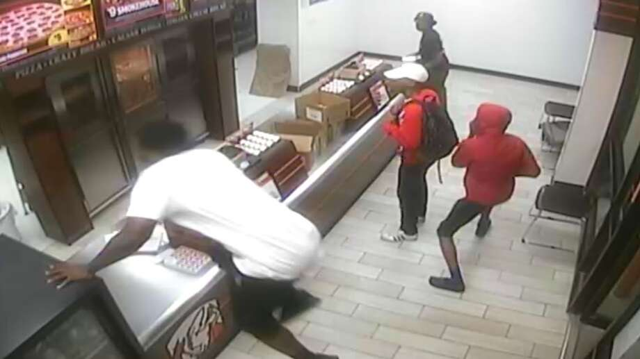 Humble police hope the public can help identify three suspects who robbed a pizza restaurant at gunpoint on Monday, April 4. Photo: Humble Police Department