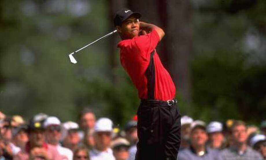 Tiger Woods in action on the final day of the 1997 Masters at Augusta, Ga. Woods went on to win the tournament with a record-low score of 18-under par. Photo: Getty Images / 2000 Getty Images