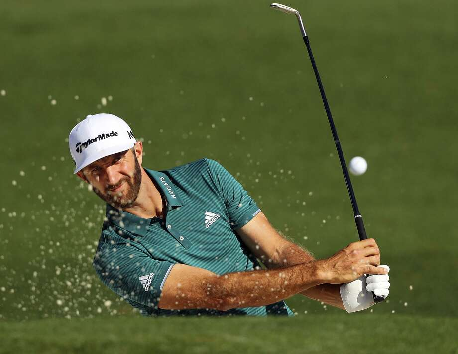 Dustin Johnson hits from a bunker to the second green during a practice round for the Masters on April 4, 2017, in Augusta, Ga. Photo: Curtis Compton /Associated Press / Atlanta Journal-Constitution