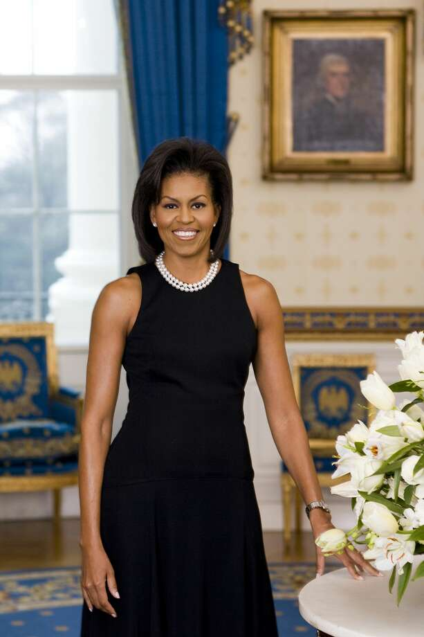 First Lady Michelle Obama poses for her official portrait in the Blue Room of the White House February 2009 in Washington, DC. This was the first time the offical First Lady portrait was captured digitally. Photo: The White House/Getty Images