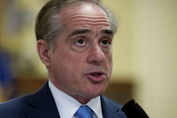 FILE - In this March 7, 2017, file photo, Secretary of Veterans Affairs David Shulkin, addresses a House Veterans' Affairs Committee's hearing on Captiol Hill in Washington. The Department of Veterans Affairs is telling skeptical lawmakers it has already fixed problems with its suicide hotline that were highlighted in an internal watchdog's report released just two weeks ago. (AP Photo/Cliff Owen, File)