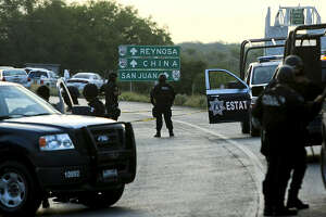 Mexican Federal personnel police block the road between the cities of Monterrey and Reynosa, Mexico, (in the border with the USA), on May 13, 2012. At least 37 mutilated bodies were found the road in the North of Mexico, surrounding the metropolitan area of Monterrey, the third most populated in the country, the State Prosecutor's Office reported . AFP PHOTO/JULIO CESAR AGUILAR        (Photo credit should read Julio Cesar Aguilar/AFP/GettyImages)