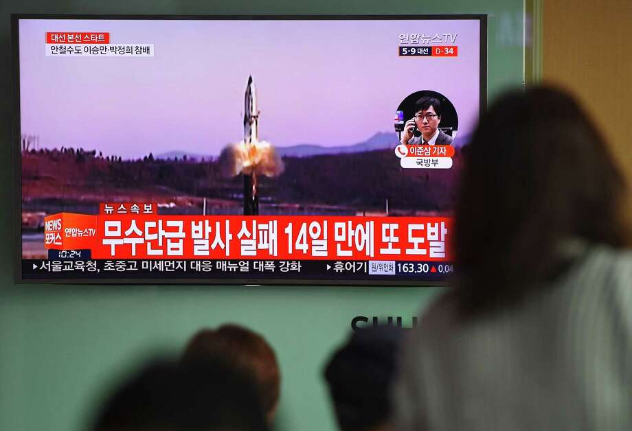 People watch a television news showing file footage of a North Korean missile launch, at a railway station in Seoul on April 5, 2017. Nuclear-armed North Korea fired a ballistic missile into the Sea of Japan on April 5, just ahead of a highly-anticipated China-US summit at which Pyongyangs accelerating atomic weapons programme is set to top the agenda. / AFP PHOTO / JUNG Yeon-JeJUNG YEON-JE/AFP/Getty Images Photo: JUNG YEON-JE, Staff / AFP/Getty Images / AFP or licensors