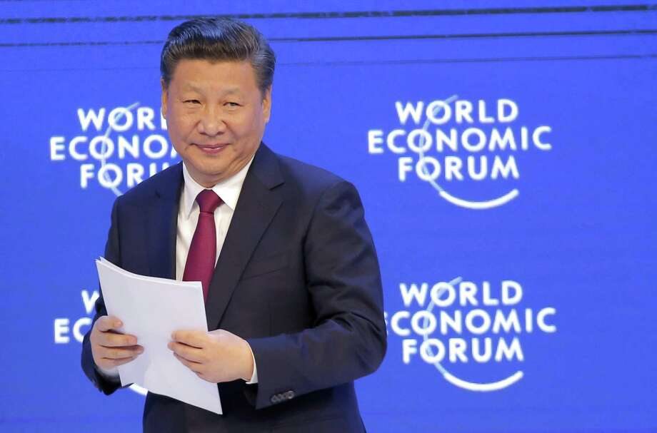 FILE - In this Jan. 17, 2017, file photo, China's President Xi Jinping smiles at the audience after his speech at the World Economic Forum in Davos, Switzerland. As U.S. President Donald Trump prepares to host his Chinese counterpart, Xi Jinping, a reversal of sorts has emerged: It's the U.S. leader who is now seen as an unpredictable wild card, skeptical of free-trade deals and their enforcement. And it's China that's cast itself as a champion of rules-based global trade. (AP Photo/Michel Euler, File) Photo: Michel Euler, STF / Associated Press / Copyright 2017 The Associated Press. All rights reserved.