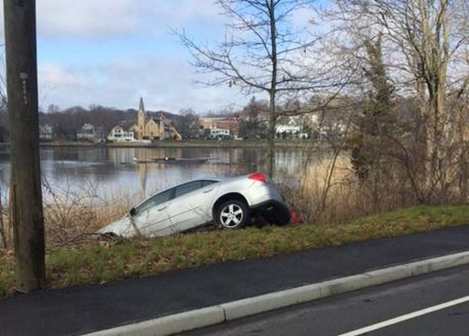 Two police officers were injured Wednesday morning on April 5, 2017 after a high-speed pursuit that ended when a vehicle crashed near the Saugatuck River.