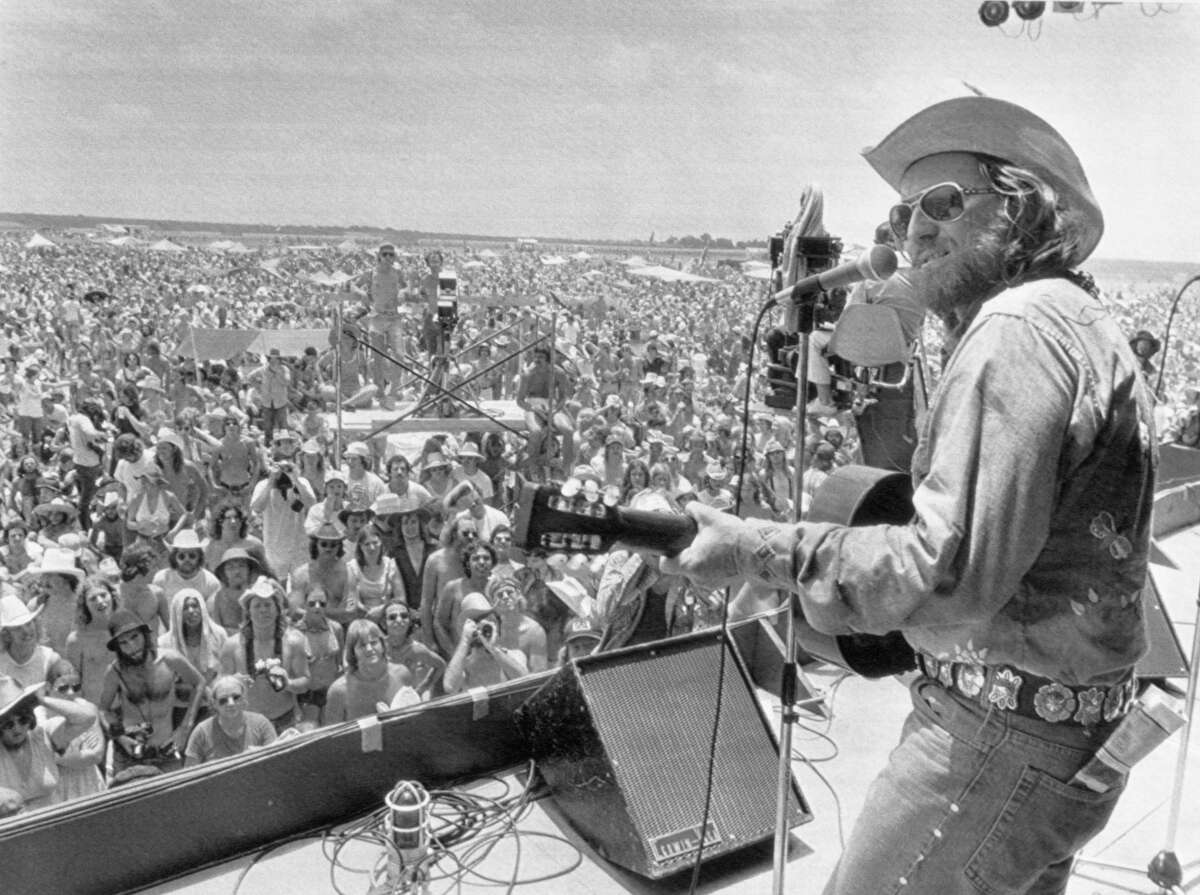 Willie Nelson thrills a young crowd 40,000 strong as he opens his 'July 4th Picnic' in 1974 in College Station. This was the festival where a fire famously destroyed Robert Earl Keen's car. See more photos from the festival through the years...