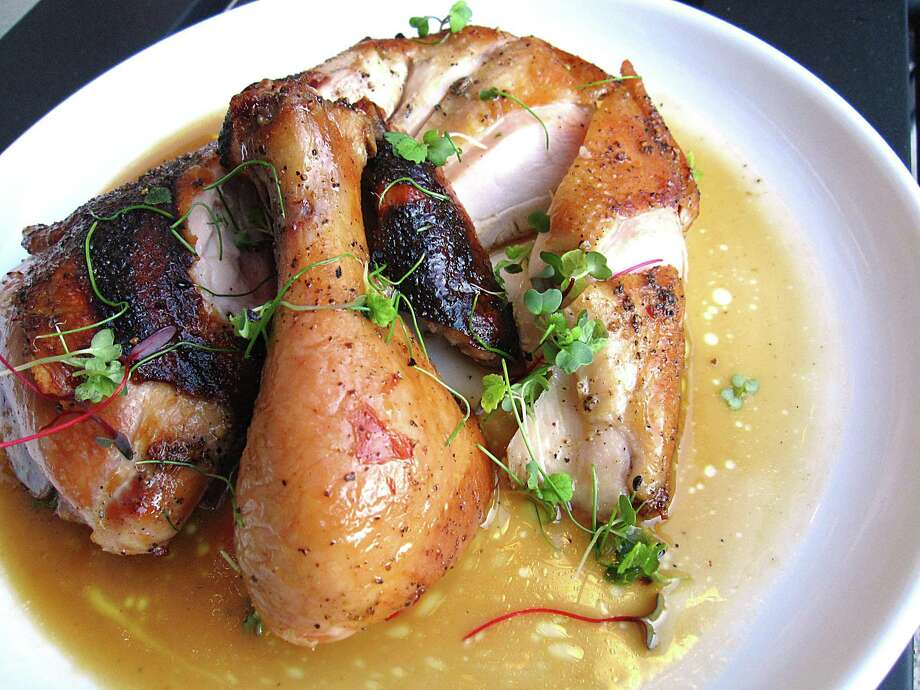 Smoke-roasted chicken with lemon-honey jus from Periphery Photo: Mike Sutter /Staff File Photo