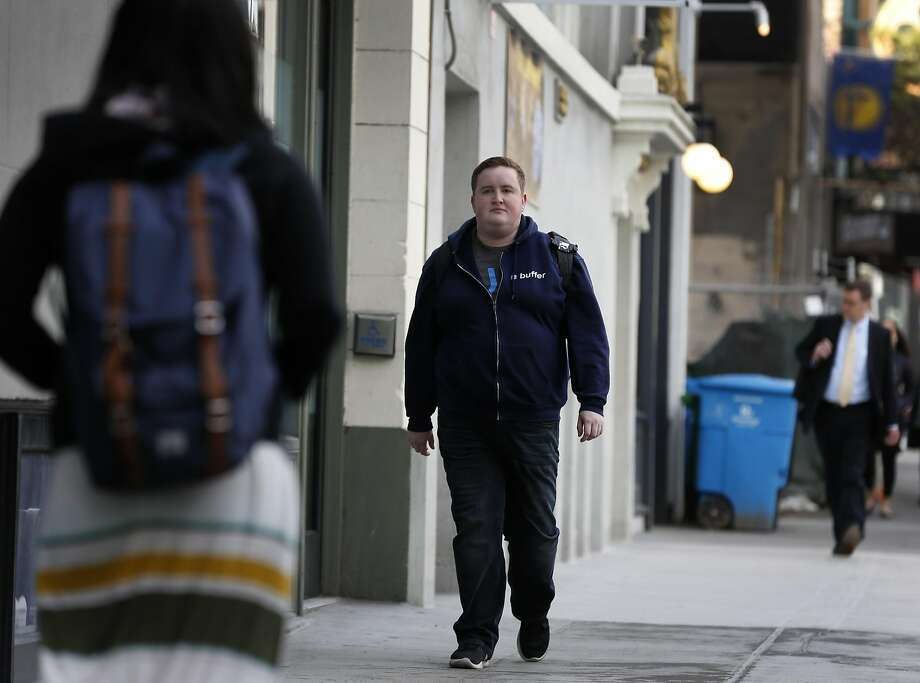 Andrew Yates walks to his job for Buffer at the Galvanize shared workspace on Howard Street in San Francisco on Wednesday. Photo: Paul Chinn, The Chronicle