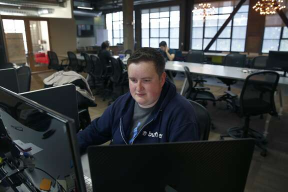 Andrew Yates logs into his job for Buffer at the Galvanize shared workspace on Howard Street in San Francisco, Calif. on Wednesday, April 5, 2017.