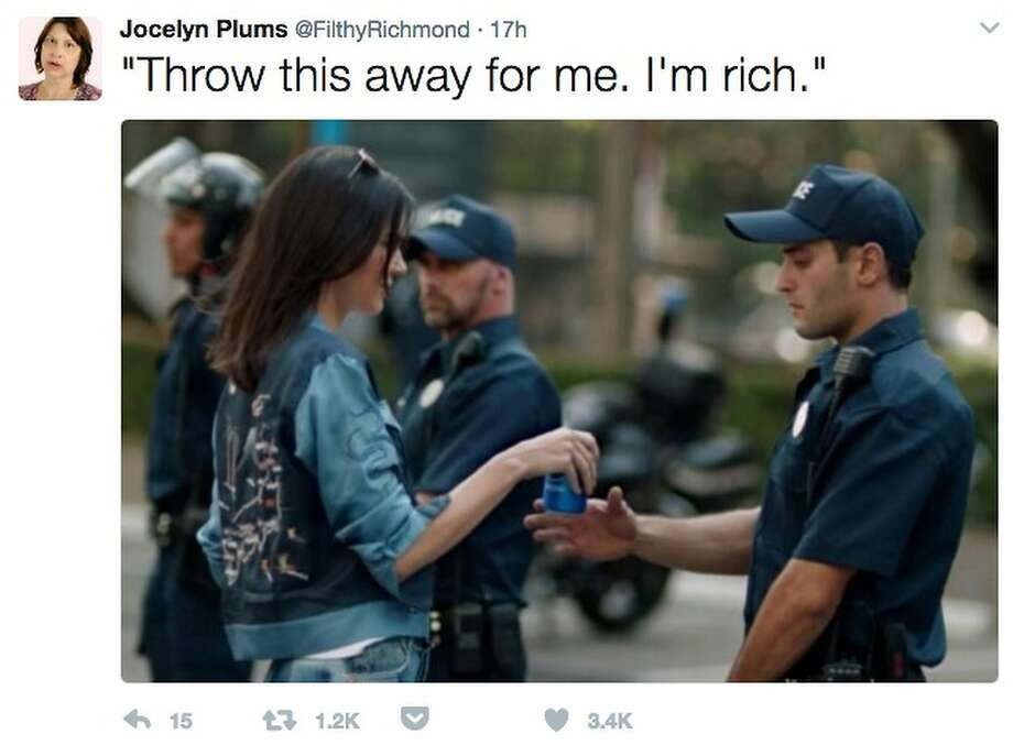 3edd96092c6 One Twitter message featured a screen shot of the moment in the commercial  when Ms. Jenner hands a can of Pepsi to a police officer who is responding  to a ...