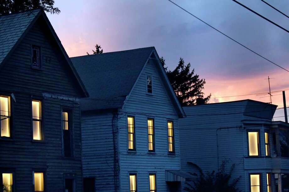 Abandoned houses pulse with light on Stanley Street as part of the Breathing Lights project on Thursday, Sept. 29, 2016, Schenectady, N.Y. (Cindy Schultz / Times Union) Photo: Cindy Schultz / Albany Times Union