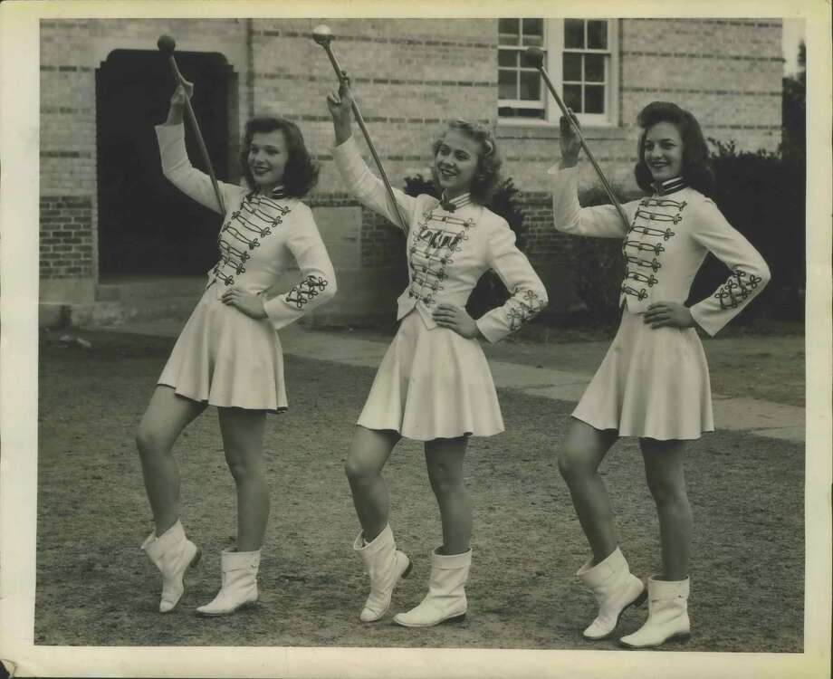 Three attractive drum majorettes who will participate in the band festival and the Battle of Flowers Parade are, left to right, Mary Helen Jeffrey, Minifred Teitschik, and Velma Wright, who are part of the Floresville High School Band. Photo: Zintgraff Photographers / San Antonio Express-News