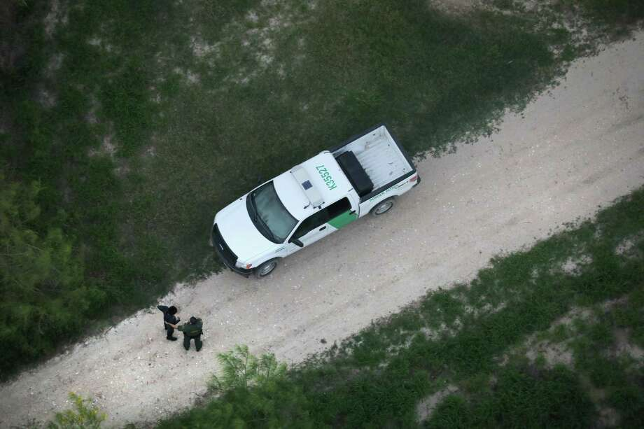LA GRULLA, TX - MARCH 15: A U.S border agent detains an undocumented immigrant near the U.S.-Mexico border on March 15, 2017 near La Grulla, Texas. U.S. Customs and Border Protection announced that illegal crossings along the southwest border with Mexico dropped 40 percent during the month of February.  (Photo by John Moore/Getty Images) Photo: John Moore, Staff / Getty Images / 2017 Getty Images