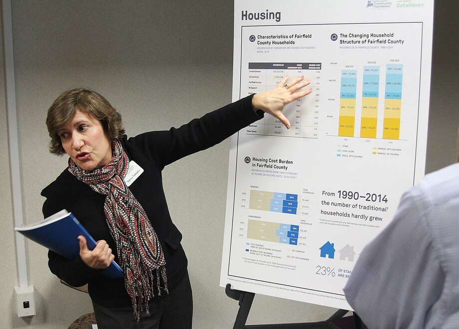 Nancy Tartaglia of Fairfield County's Community Foundation leads a discussion on housing data included in the Fairfield County Community Wellbeing Index 2016 at a public forum held Tuesday, April 4, 2017, at Danbury Library in Danbury, Conn. Photo: Chris Bosak / Hearst Connecticut Media / The News-Times