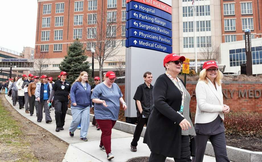 Walkers from Albany Medical Center and the American Heart Association stroll through the Park South neighborhood for National Walking Day on Wednesday, April 5, 2017, in Albany, NY. (John Carl D'Annibale/Times Union)   Photo: John Carl D'Annibale/Times Union