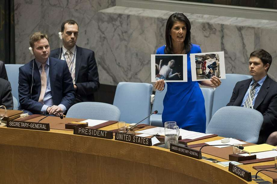 U.S. Ambassador to the United Nations Nikki Haley holds up photos of victims of the apparent chemical attack in Khan Sheikhoun, Syria, during a meeting of the U.N. Security Council. Photo: Drew Angerer, Getty Images