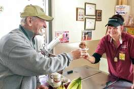 Frank Faragon, left, of Colonie gets a Valentine's Day 50 cents single scoop ice cream cone from Stewart's Shops Everett Road manager Chriss Overholt Tuesday Feb. 14, 2017 in Colonie, NY.  (John Carl D'Annibale / Times Union)