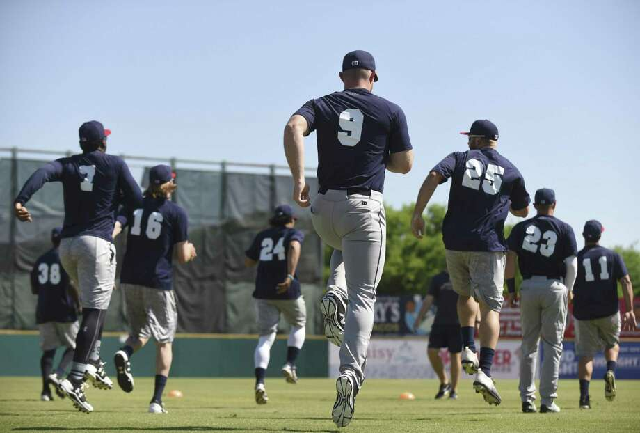 Players limber up during the San Antonio Missions annual media day workout at Wolff Stadium on April 4, 2017. Photo: Billy Calzada /San Antonio Express-News / San Antonio Express-News