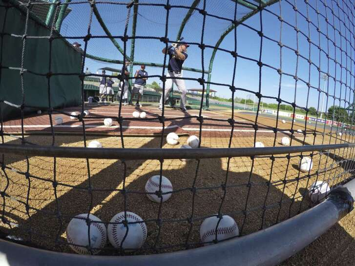 Catcher Stephen McGee hits in the batting cage during the San Antonio Missions annual media day workout at Wolff Stadium on April 4, 2017.