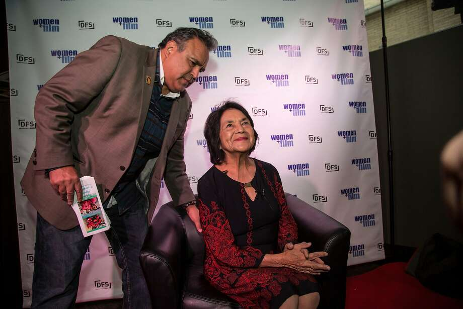 """Dolores Huerta, the co-founder of the United Farm Workers union, is helped by her son Emilio Huerta before an interview for a screening of the film """"Dolores"""" in in Denver. Photo: Nathan W. Armes, Special To The Chronicle"""