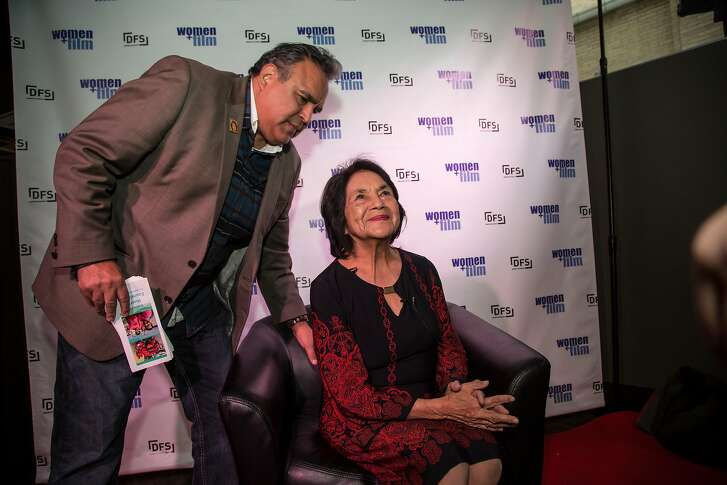 Dolores Huerta, 87, the co-founder of United Farm Workers, visits Denver, CO for an April 4, 2017 Women+Film Festival screening of a new documentary showcasing her life and activism. Huerta's son, Emilio Huerta, helps his mother before an interview by student filmmakers at the screening of the documentary.