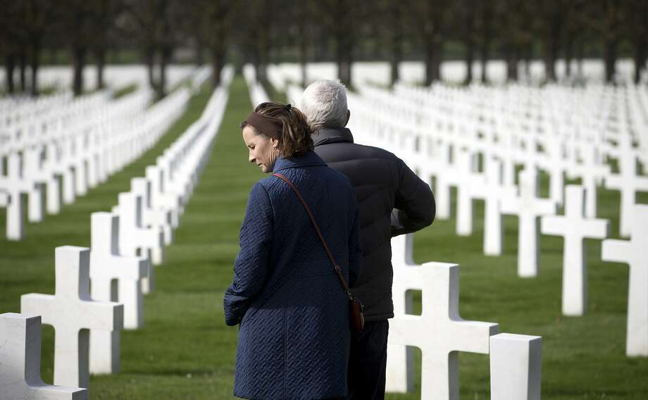 Mary and Bob Thomson of West Virginia walk through the rows of crosses for U.S. World War I soldiers at the Meuse-Argonne American cemetery in Romagne-sous-Montfaucon, France. Photo: Virginia Mayo, Associated Press
