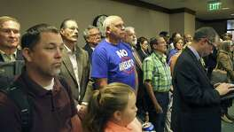 "Mike Kantor stands with his ""no annexation"" T-shirt on April 5 as supporters of limitations on municipal expansion crowd into the back of the room for a hearing on Senate Bill 715, as Sen. Donna Campbell, R-New Braunfels, presents the bill to Senate Intergovernmental Relations Committee. The bill passed the Senate on Monday."