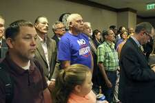 """Mike Kantor stands with his """"no annexation"""" T-shirt on April 5 as supporters of limitations on municipal expansion crowd into the back of the room for a hearing on Senate Bill 715, as Sen. Donna Campbell, R-New Braunfels, presents the bill to Senate Intergovernmental Relations Committee. The bill passed the Senate on Monday."""