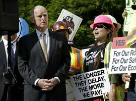 California Gov. Jerry Brown waits to speak a rally to urge lawmakers to approve a plan for a $5 billion-a-year tax and fee road repair measure during a rally Wednesday, April 5, 2017, in Sacramento, Calif. The bill, SB1, supported by Brown and Democratic Legislative leaders, is expected to be voted on by the California Legislature on Thursday. (AP Photo/Rich Pedroncelli)