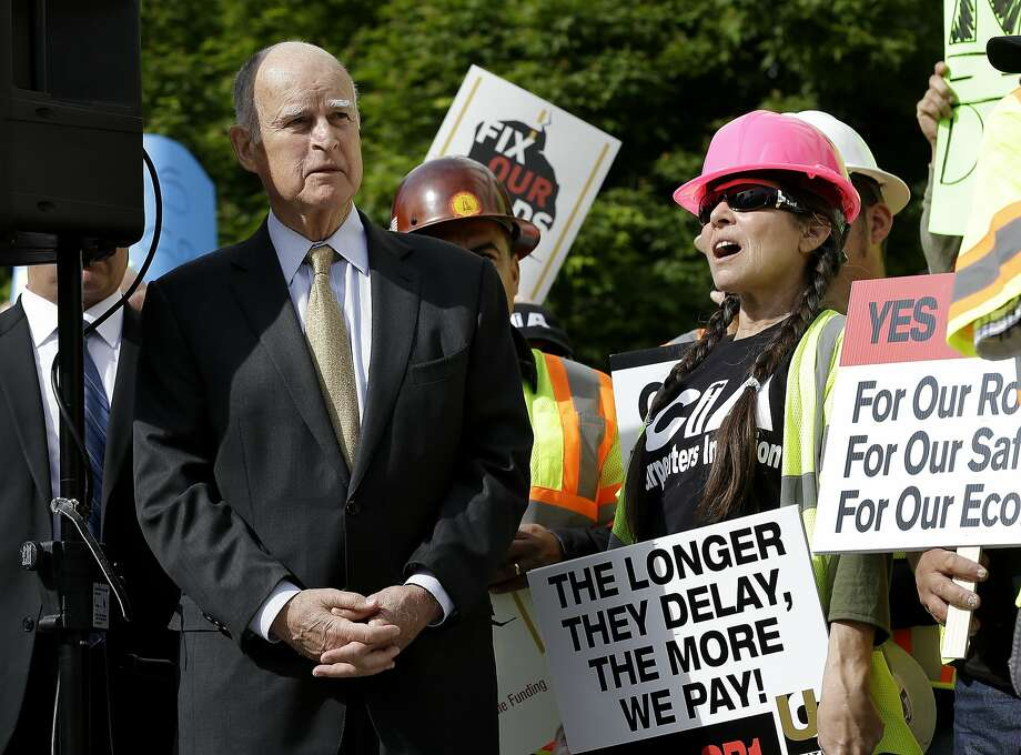 California Gov. Jerry Brown waits to speak a rally to urge lawmakers to approve a plan for a $5 billion-a-year tax and fee road repair measure during a rally Wednesday, April 5, 2017, in Sacramento, Calif. The bill, SB1, supported by Brown and Democratic Legislative leaders, is expected to be voted on by the California Legislature on Thursday. (AP Photo/Rich Pedroncelli) Photo: Rich Pedroncelli, Associated Press