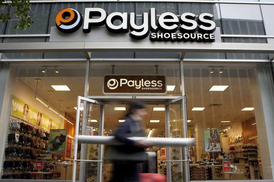 A pedestrian passes in front of a Payless ShoeSource Inc. store in New York. Photo: Scott Eells, Bloomberg