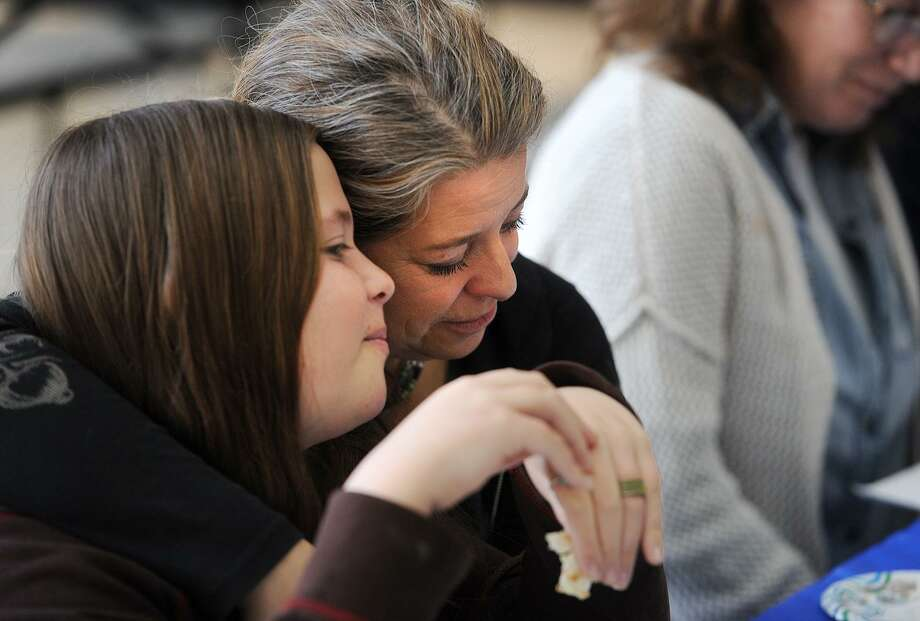 Zoey Greenbaum, 11, and her mom Jill Scholsohn, of Kent, enjoy The Congregation of Humanistic Judaism Sunday school model Passover Seder at Bedford Middle School in Westport, Conn. on Sunday, April 2, 2017. Part of the mission of the congregation, founded in 1967, is to celebrate Jewish holidays and traditions in non-theistic ways. Photo: Brian A. Pounds / Hearst Connecticut Media / Connecticut Post