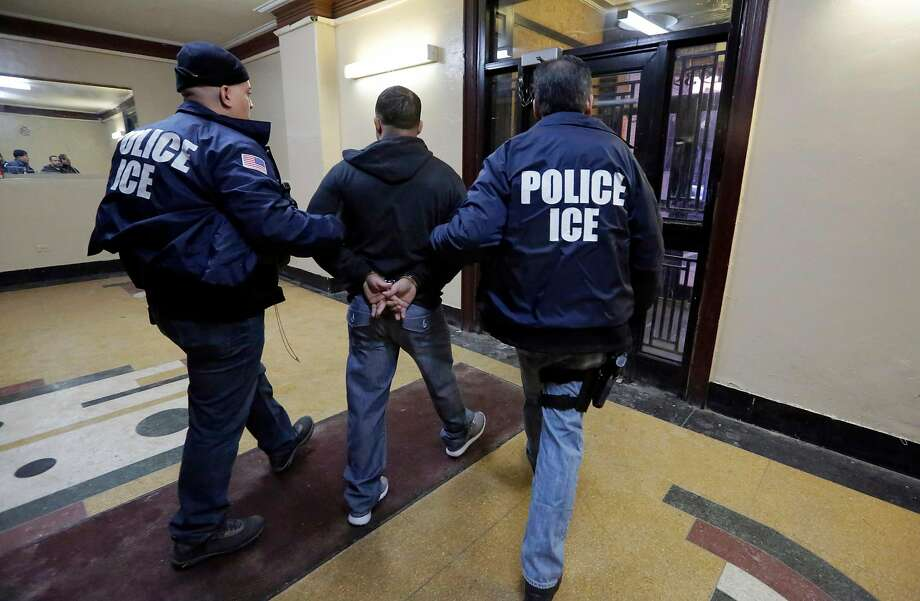 Immigration and Customs Enforcement officers making an arrest. Photo: Richard Drew, AP