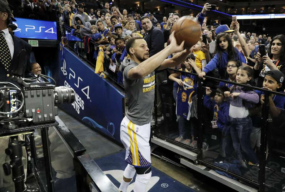 """In this file photo, Stephen Curry's """"tunnel shot"""" is filmed by a set of VR cameras before the Golden State Warriors played the Minnesota Timberwolves at Oracle Arena in Oakland, Calif., on Tuesday, April 4, 2017. Photo: Carlos Avila Gonzalez, The Chronicle"""