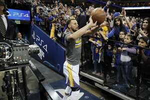 """Stephen Curry's """"tunnel shot"""" is filmed by a set of VR cameras before the Golden State Warriors played the Minnesota Timberwolves at Oracle Arena in Oakland, Calif., on Tuesday, April 4, 2017. NextVR, which is working on beaming live sporting around the world in VR, is broadcasting Tuesday night's Warriors game from Oracle Arena. That includes a special production truck outside, with seven VR cameras court side and elsewhere, with a dedicated announcing crew."""