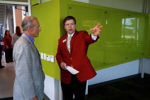 Dan Hallmark listens as mechanical engineering student Marcus Rodgers gives him a tour during a dedication ceremony for the new Center for Innovation, Commercialization and Entrepreneurship at Lamar University on Wednesday. The center aims to bring together science, engineering and business students to build business opportunities around their research. The second floor of the building also has office space and resources for new start-ups. Photo taken Wednesday 4/5/17 Ryan Pelham/The Enterprise