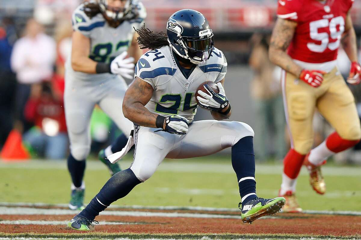 Marshawn Lynch #24 of the Seattle Seahawks rushes with the ball against the San Francisco 49ers during their NFL game at Levi's Stadium on October 22, 2015 in Santa Clara, California.