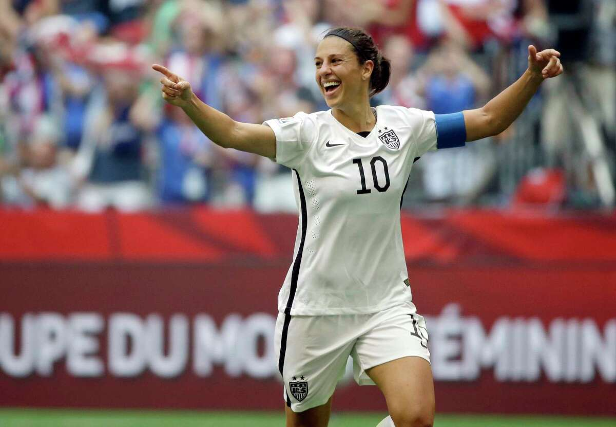 FILE - In this July 5, 2015, file photo, Carli Lloyd of the U.S celebrates scoring her third goal against Japan during the first half of the FIFA Women's World Cup soccer championship in Vancouver, British Columbia, Canada. England's soccer leaders want to restrict the number of foreign players in their top women's league and introduce salary caps to tackle the growing financial gulf between clubs. Manchester City's signing of FIFA world player of the year Lloyd is embraced by a governing body keen to raise the standards in its league, as is the club's decision to divert funding from the men's team to the loss-making women's setup. (AP Photo/Elaine Thompson, File)